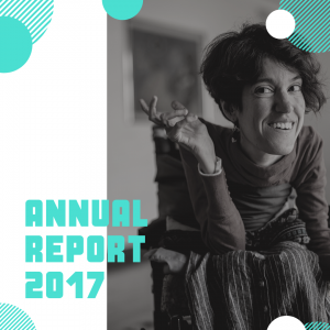 Annual Report 2017 - Woman in wheelchair with short, curly dark hair smiling.