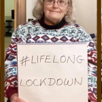 Woman holding a #LifelongLockdown sign