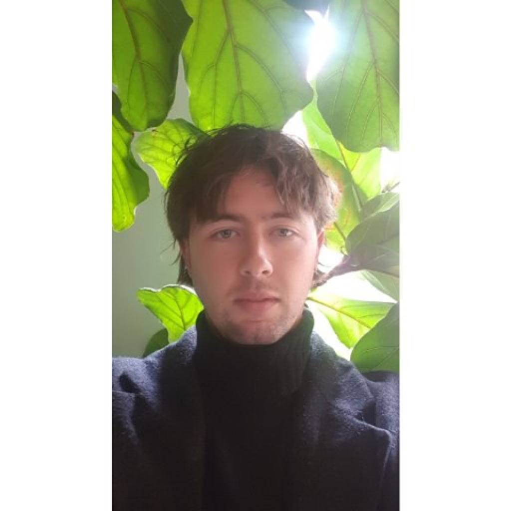 Portrait of a man framed by leaves