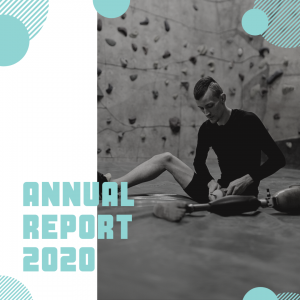 Image: a tall skinny man with a mohawk in a rock climbing gym. He is putting on a prosthetic leg. Text: Annual Report 2020