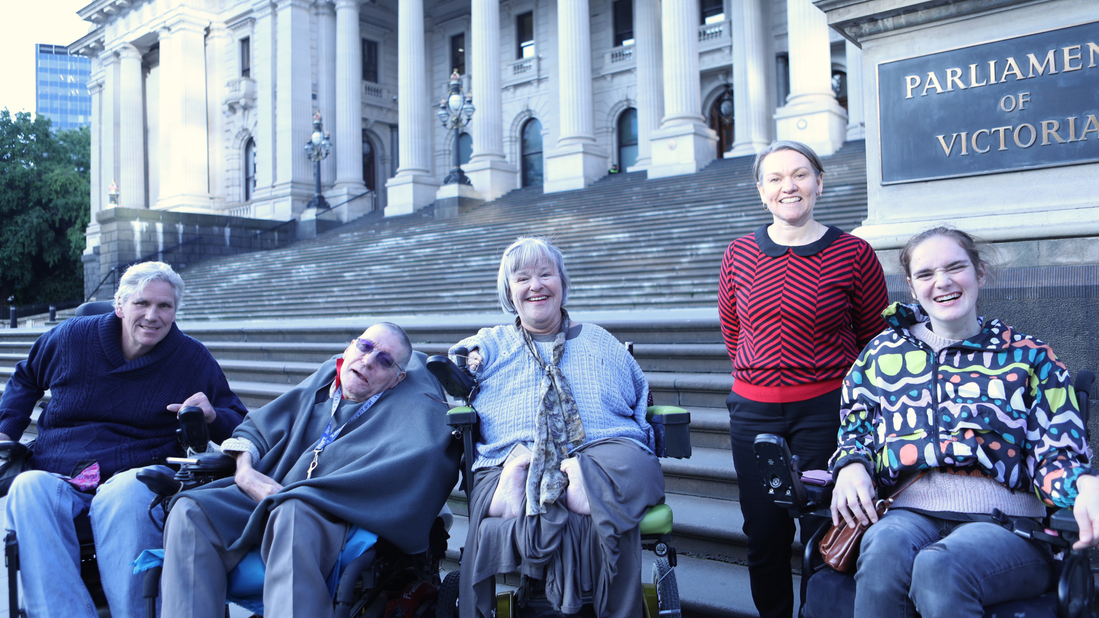 L-R: DRC Secretary Martin Leckey, DRC CoM Member Frank Hall-Bentick, DRC Chairperson Mary Henley-Collopy, DRC Executive Officer Kerri Cassidy, DRC Member Stella Barton lined up at the base of the steps of the Victorian Parliament.